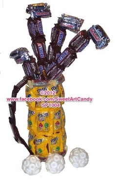 Golf Clubs for the golf enthusiast in your like. This sweet treat as a gift will surely be a hole in 1. Created with Snickers, 3 Muskateer, M&M's, Hershey Bars, Whoppers and Life Savers.