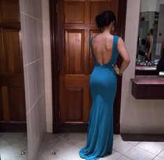Teal blue formal dress with open back