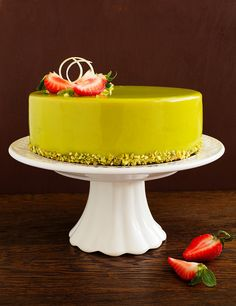 Delicious strawberry-pistachio mousse cake with a smooth glaze.
