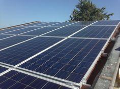 Impianto fotovoltaico ad ANCONA da 10,00 kWp su copertura - 40 moduli AXITEC in SILICIO POLICRISTALLINO da 250 Wp - UTILIZZO di OTTIMIZZATORI di POTENZA (SOLAREDGE)