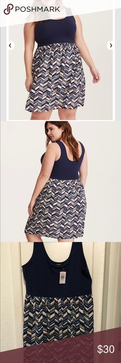 Torrid dress size 1 navy color top We can't choose which half of this dress we like more; luckily, we don't have to with this two-in-one style. The navy stretchy knit tank bodice has tee-like feels (stretchy, soft, comfy), while the ivory skirt embraces your attention-grabbing side with a multi-color chevron print. torrid Dresses Midi