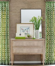 How fresh and lovely is this vignette framed by fab green and white Kelly Wearstler Imperial Trellis curtains?