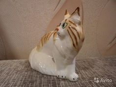 Статуэтка кошка мейн кун (кот).  Высота 11,5 см, длина 14. Фаянс. Стоимость одной фигурки 430 рублей.