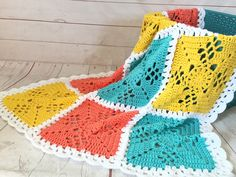 Turquoise, yellow, peach and white granny square afghan. This is a very special handmade crochet baby blanket. This baby afghan will make a wonderful baby shower gift. This blanket would make a lovely addition to your baby nursery decor. Perfect also, for travel, strollers, prams, cribs, tummy time and photo props