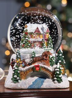 The globe showcases a beautiful gray horse decked out in regal blue winter attire. The snow globe plays the tune of Jingle Bells. Christmas Snow Globes, Christmas Love, Christmas Pictures, Beautiful Christmas, Merry Christmas, Hades Disney, Snow Globe Crafts, Glitter Globes, Musical Snow Globes