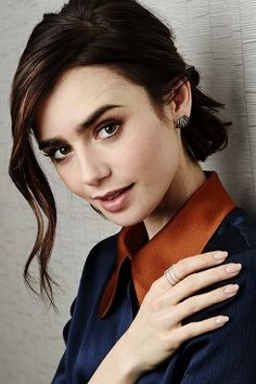 Lily Collins, actress (daughter of Phil Collins, lead vocalist & drummer for Genesis)