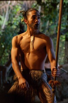 """Maori warrior wielding """"taiaha,"""" a staff weapon used for short sharp strikes or stabbing thrusts"""