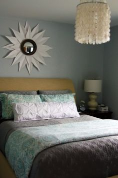 Love the turquoise on the gray bed coverings.