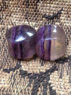 flourite stone plugs. $30.00, via Etsy.