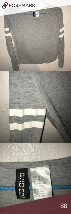 Grey and white striped long sleeve top H&M cropped grey long sleeve shirt with white stripes on the sleeves. H&M Tops Tees - Long Sleeve