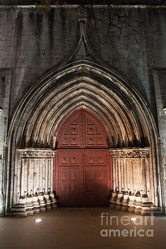 Gothic portal to the Carmo Church and Convent illuminated at night in Lisbon, Portugal. #lisbon #carmochurch #cathedral #church #carmo #lisboa #portugal #gothic #portal #door #historic #night #artprint #fineart #fineartprints #convent #old #ancient #medieval #christian #building #carmoconvent #architecture #gothicstyle