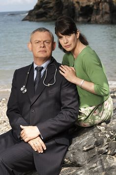 Image shows from L to R: Dr Martin Ellingham (Martin Clunes), Louisa Glasson (Caroline Catz). Doc Martin Tv Show, Bbc Tv Shows, Martin Clunes, Dr Martins, British Comedy, Comedy Tv, Tv Actors, Celebrity Couples