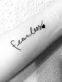 What does fearless tattoo mean? We have fearless tattoo ideas, designs, symbolism and we explain the meaning behind the tattoo. Wörter Tattoos, Et Tattoo, Neue Tattoos, Trendy Tattoos, Forearm Tattoos, Finger Tattoos, Cross Tattoos, Tatoos, Faith Tattoos