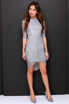 "She looks like an angel, and walks like an angel, but in the Angel Eyes Grey Lace Dress, you just never know! This sultry light grey dress has an enticing bodycon fit covered in beautiful floral lace. A round-neck bodice includes sheer half sleeves trimmed in eyelash lace, with a matching peekaboo high-low hem. Hidden back zipper/hook clasp. Lined to mid-thigh. Dress measures 7"" longer at back. Self: 100% Nylon. Lining: 100% Polyester. Hand Wash Cold. Imported."