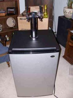 DIY Kegerator.  Holds two home brew kegs.  Must have.
