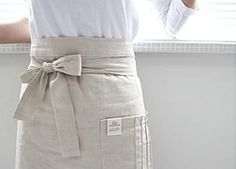 """Yes, but maybe darker for night hours, """"fortune cookie"""" tie for men? Cafe Uniform, Cafe Apron, Restaurant Uniforms, Staff Uniforms, Waist Apron, Apron Designs, Linen Apron, Sewing Aprons, Moda Casual"""