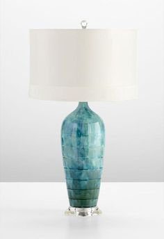 Elsia Table Lamp  Item # 12290  A gorgeous fusion of blue glazes the ceramic base of our Elsia Table Lamp. The simple white silk fabric shade rests atop the cool base for a refreshing look.  Size 	28.5HX16W  Color 	BLUE  Price 	$299
