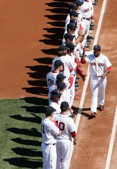 Home Opener: Boston Red Sox's Jackie Bradley Jr. is greeted by teammates after being announced before their baseball game against the Baltimore Orioles at Fenway Park in Boston Monday, April 8, 2013. (AP Photo/Winslow Townson)
