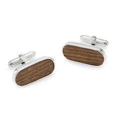 When you don your Derby Day-best, no other cufflinks will do. This winning set is fashioned out of wood sourced from one of the Kentucky Derby's most storied sites, Churchill Downs.