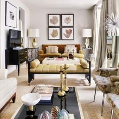 There is much to ditto from this narrow, yet soothing, living room space that uses designer tricks. {design by Carrera and Fauquié}