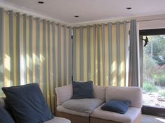 Eyelet curtains made with linen/ cotton mix Coastlines- Beach hut . Hanging on a Satin Nickel metal pole which is available in a range of colours .This blue and off white fabric is a heavy weight and is suitable for curtains, blinds, soft furnishings and light upholstery.