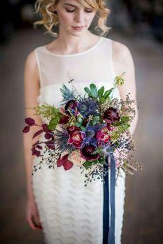 Blue Eryngium Thistle, Merlot Ranunculus, Cranberry Orchids, Cream Roses, Blue Privet Berries, Seeded Eucalyptus, Burgundy & Green Foliage××××