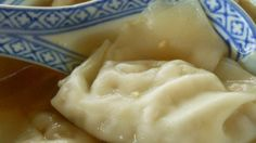 Prepared wontons float in a broth made spicy with the addition of chile-garlic sauce in this soup recipe.
