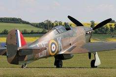 "Hawker Hurricane Mk X, AE977. For its role in the Eagle Squadron, '977 adorned the colours of P3886, coded UF-K, of 601 (County of London) Squadron, Royal Auxiliary Air Force, an aircraft flown by both William Meade Lindsley ""Billy"" Fiske III and Carl Raymond Davis. One of only eleven American pilots active with Fighter Command during the Battle of Britain, Pilot Officer Fiske was the first to give his life while serving with the RAF."