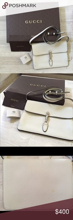 Gucci White Leather Cross Body/Clutch Genuine white leather, lightly worn with two small stains one In front and the other on the back (pictures included) Inside is in good condition, no stains. Receipt and box included. Original price $968.89. No trades please. Gucci Bags Crossbody Bags