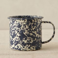 """Inspired by vintage enamel finds, this classic mug is topped with a speckled finish.- Metal, enamel- Dishwasher safe- Imported3""""H, 3.5"""" diameter"""