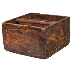 Distressed wood box with iron accents and a carrying handle.  Product: BoxConstruction Material: Wood and iron