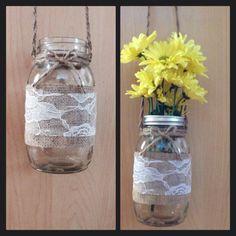 Hanging mason lantern Large Ball mason jar Twine harness; 15 inch Fray glued Double sided burlap Outside: brown burlap Inside: Camo burlap White