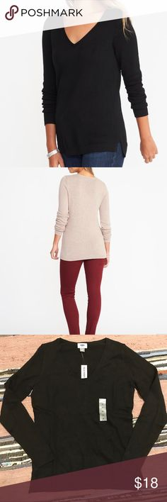 Classic vneck sweater Materials & Care 55% cotton , 25% viscose rayon, 20% nylon. Machine wash. Imported. Product Details V-neck. Long sleeves, with rib-knit cuffs. Stepped hem, with vented sides. Soft, medium-weight cotton blend. Old Navy Sweaters V-Necks