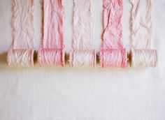 DIY hand dyed ribbon made from a cut of silk fabric which is ripped into smaller strips and dyed...would be gorgeous for the invitations as well as any other ribbon needed for the wedding decor. In a light blush.
