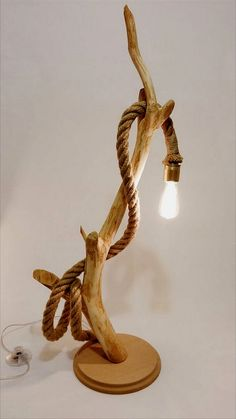 This handmade wood lamp is crated by Woodarium Design&Decoration. -Organic wood -Vintage look bulb -Rope -Modern Switch You can decorate your home or office. Width: Length: Height: Shipped with the bulb!