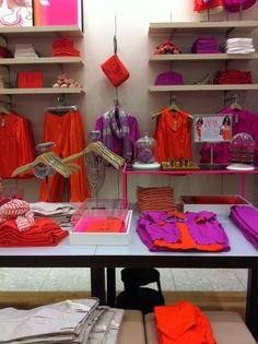 This was taken at Ann Taylor on Fifth Avenue in NYC Feb,2012. The colour blocking is one thing, but the ease with which you could choose an outfit AND accessories in about 90 seconds flat? That is the genius of this wall! Viva le 1980's!!
