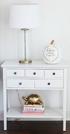 How to create the perfect white bedroom on a budget - including this cute white side table with fun home decor accents | Orlando, Florida lifestyle blogger Ashley Brooke Nicholas | fall decor | affordable home decor | holiday decor | shabby chic decor | feminine style | feminine decor | blogger home tour | blogger bedroom | white bedroom