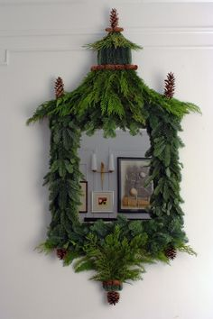 Mirror adorned with greenery and pine cones