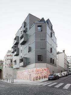 Karawitz has completed a housing block overlooking the Ourcq canal, which features balconies framed by light-grey boxes and an external corkscrew staircase.