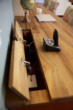 Flip- up panel on desk hides cords Do this for the back of a TV unit to hide a serge protector power bar