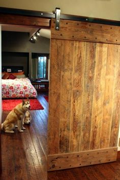 Standard Flat Track from Barn Door Hardware blends seamlessly with warm rustic wood doors.