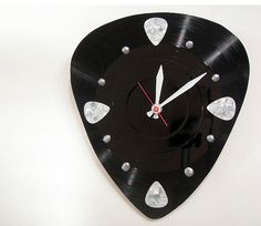 Hey, I found this really awesome Etsy listing at https://www.etsy.com/listing/96984000/music-clock-guitar-pick-pick-your-own