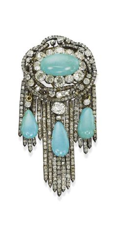 AN ANTIQUE DIAMOND AND TURQUOISE BROOCH