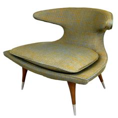 """""""Horn"""" Lounge Chair by Karpen, ca. 1950's, with walnut stiletto legs and retaining its original fabric."""