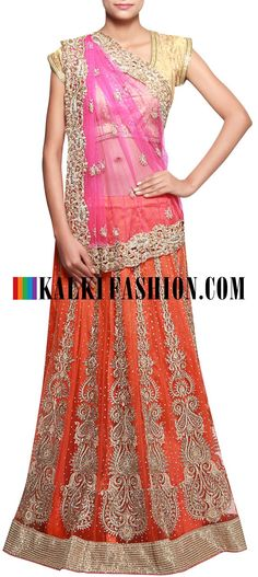 Get this beautiful lehenga here: http://www.kalkifashion.com/orange-and-pink-lehenga-embellished-in-kundan-emboridery-only-on-kalki.html Free shipping worldwide.