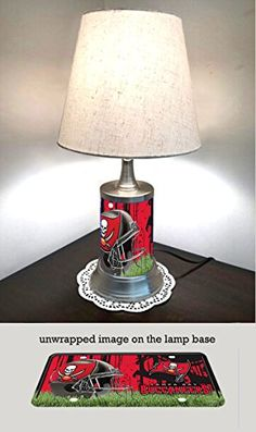 Tampa Bay buccaneers Lamp with shade  https://allstarsportsfan.com/product/tampa-bay-buccaneers-lamp-with-shade/  The lamp base is made of sturdy metal Approximately 18 in. H x 10 in. W A metal plate was rolled to make the body of the lamp base