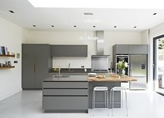 Roundhouse Urbo grey matt lacquer bespoke kitchen with Zebrano island
