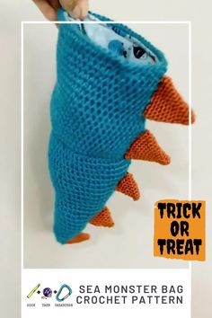 The all in one treat bag - chalk bag- costume! Wear it to the crag, or fill it with candy and wear it trick or treating! hookyarncarabiner.com #halloween #costume #crocheted #crochet #pattern #handmade #seamonster #spines #blue #orange #trickortreat #treatbag #chalkbag #rockclimb