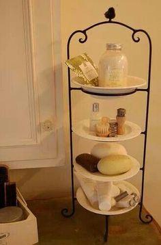 Plate rack in the bathroom. Cute idea for countertop stuff