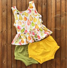 A personal favorite from my Etsy shop https://www.etsy.com/listing/540475249/baby-toddler-girls-pears-peplum-tank